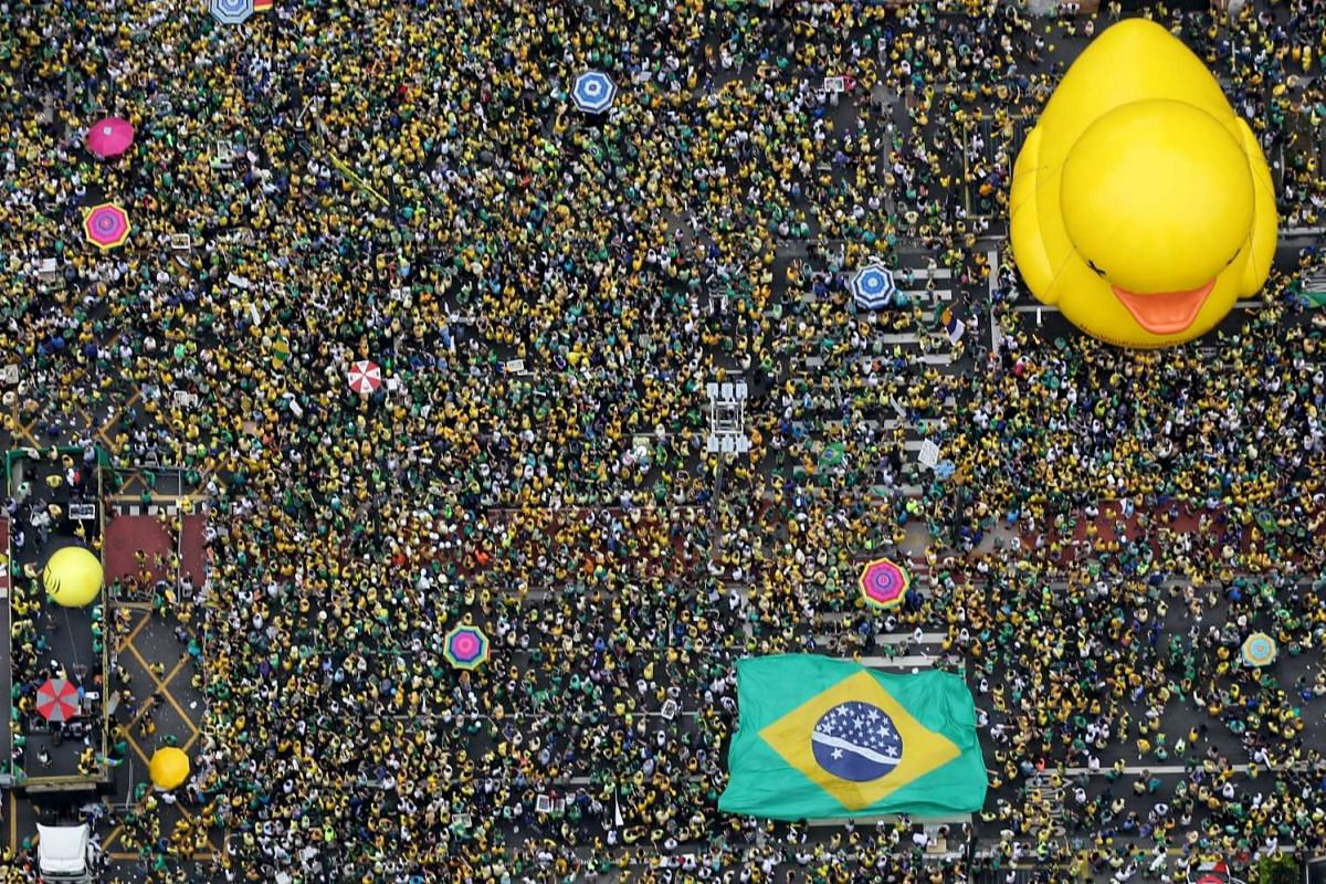 Demonstrators attend a protest against Brazil's President Dilma Rousseff, part of nationwide protests calling for her impeachment, in Sao Paulo, Brazil, March 13, 2016. PHOTO: REUTERS