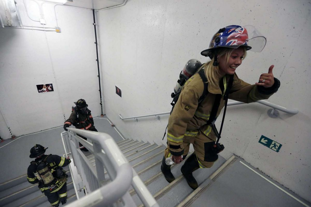 A woman firefighter from New Zealand walks up the steps during the 2nd Annual New York City Firefighter Stair Climb at 4 World Trade Center in New York, New York, USA, March 13, 2016. PHOTO: EPA