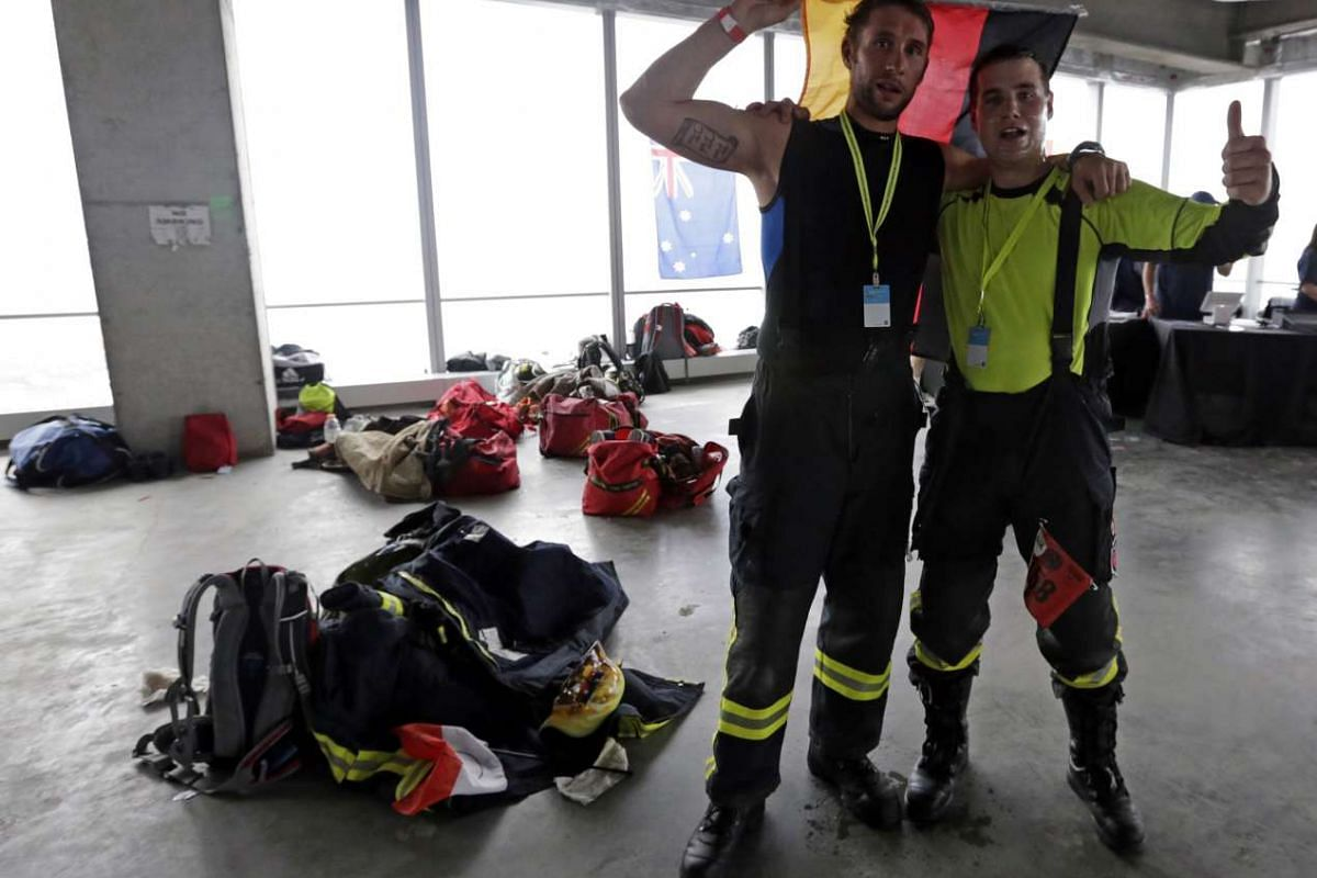 German firemen Joachim Kimber (left) and Wolfgang Eger (right) pose after completing in the 2nd Annual New York City Firefighter Stair Climb at 4 World Trade Center in New York on March 13, 2016.