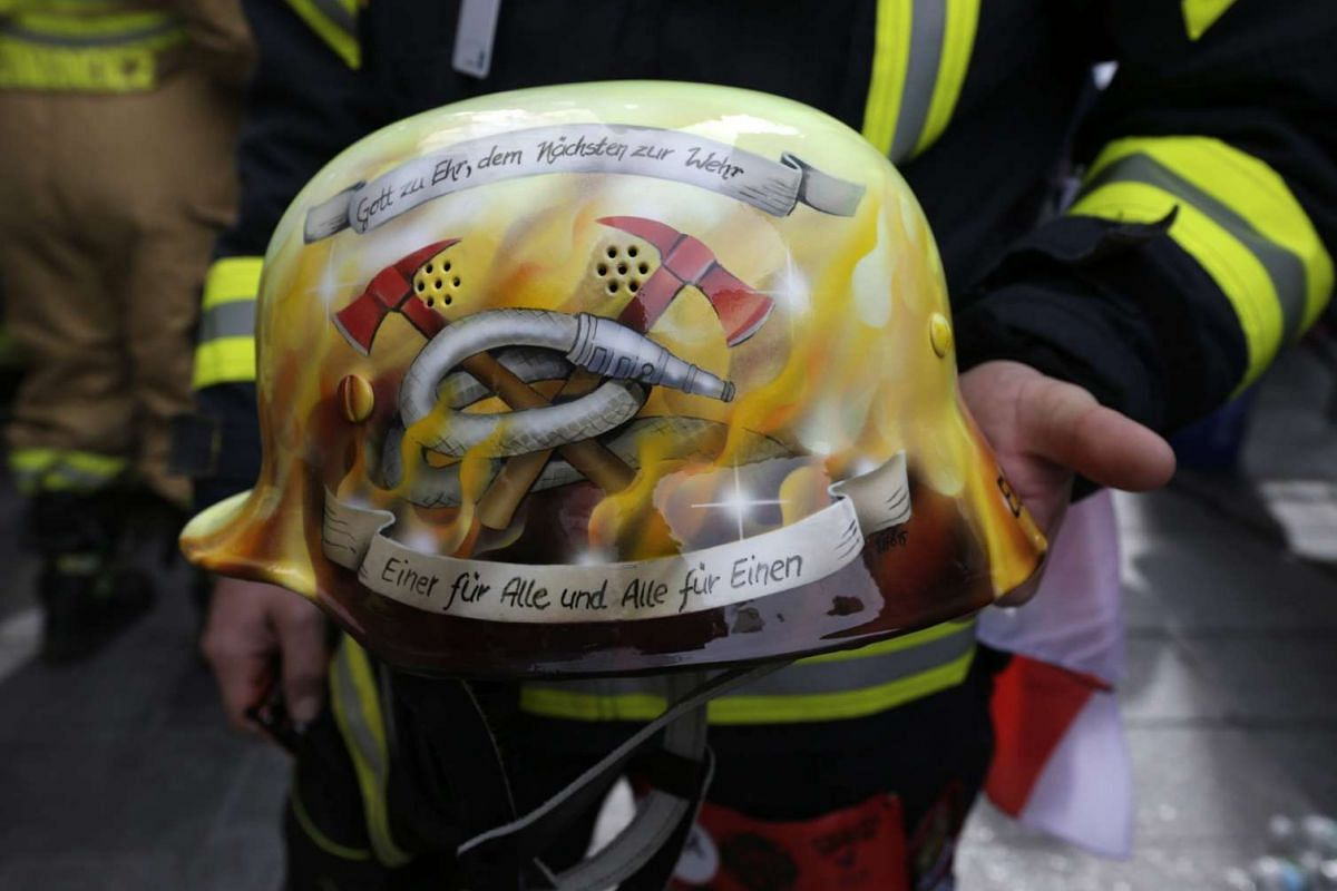 German fireman Wolfgang Eger's helmet is seen before the 2nd Annual New York City Firefighter Stair Climb at 4 World Trade Center in New York on March 13, 2016.
