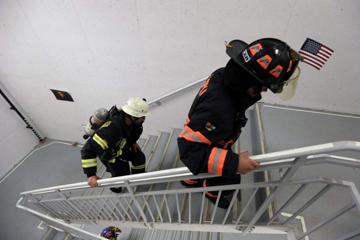 German fireman Joachim Kimber (left) is seen walking up the steps during the 2nd Annual New York City Firefighter Stair Climb at 4 World Trade Center in New York on March 13, 2016.