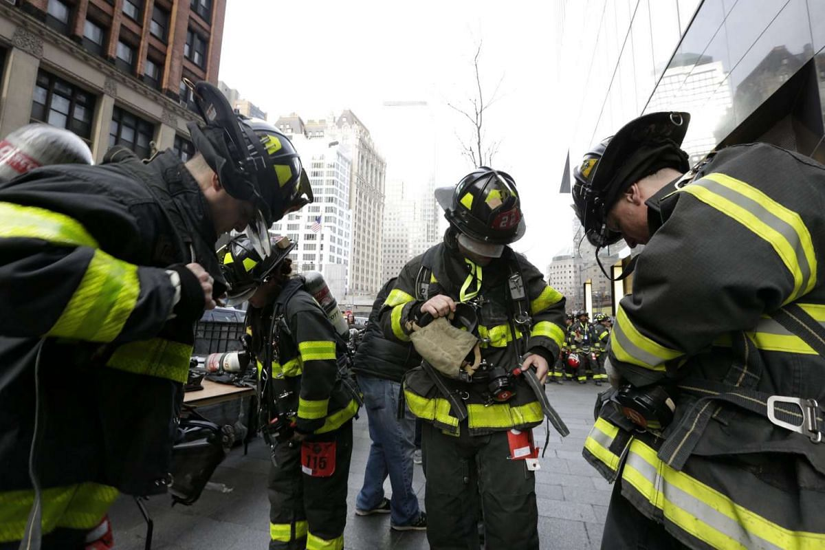 New York City firefighters are seen prepping their equipment before the start of the 2nd Annual New York City Firefighter Stair Climb at 4 World Trade Center in New York on March 13, 2016.