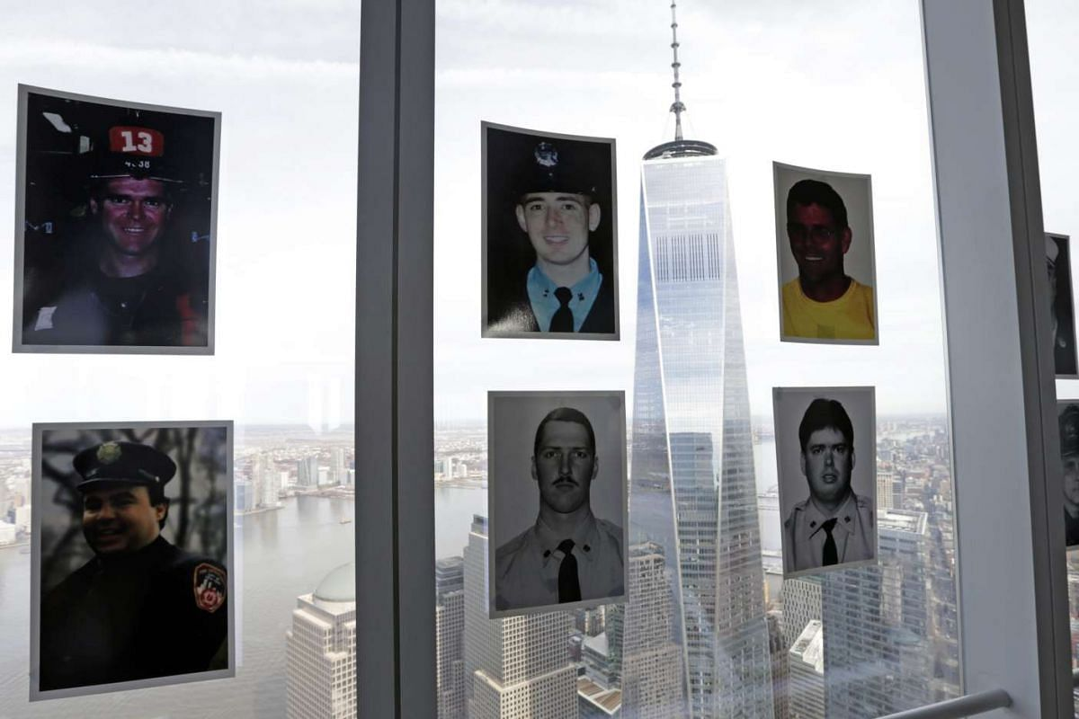 Fallen New York City firemen's pictures are seen on the window of 4 World Trade Center during the 2nd Annual New York City Firefighter Stair Climb at 4 World Trade Center in New York on March 13, 2016.