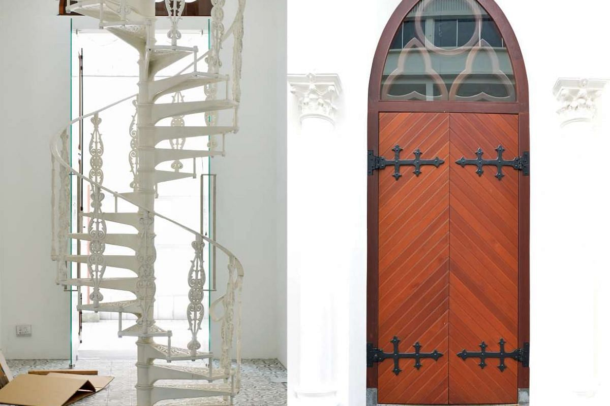 A new cast-iron spiral staircase inside the restored church (left). Although the church doors (right) were reconstructed using new wood, the original hinges were restored and reused.
