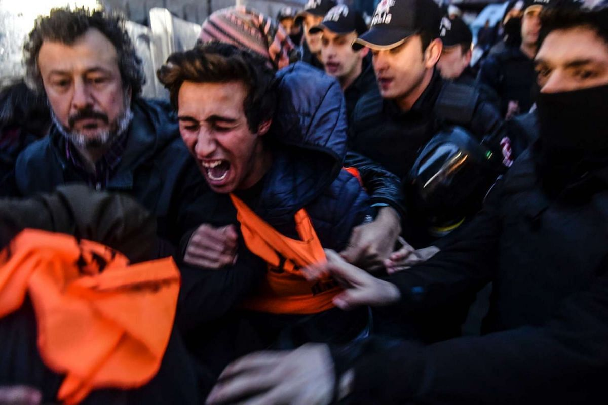 A man reacts as Turkish police clash with protesters in Istanbul on March 14, 2016 during an anti-government protest in memory of the victims of the suicide car bombing in Ankara the day before. PHOTO: AFP
