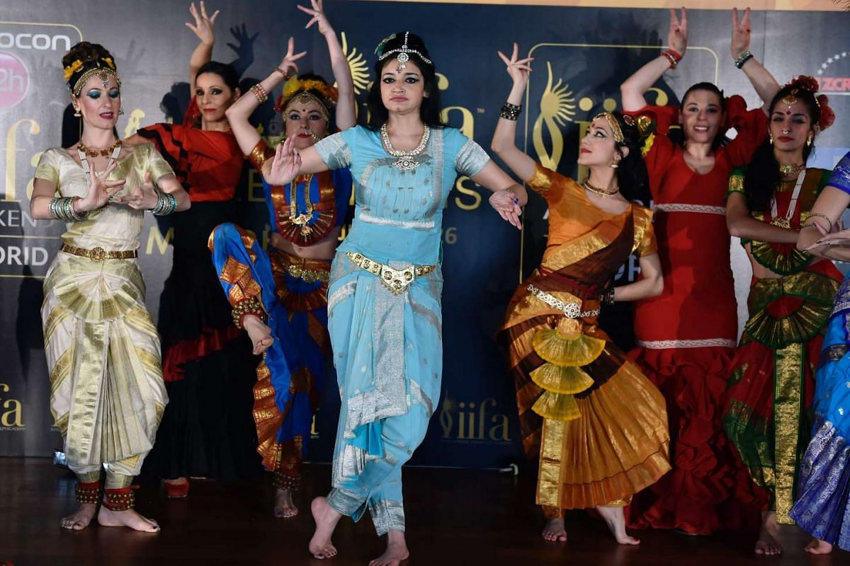Dancers perform before a press conference held to present the Bollywood Oscars, in Madrid, on March 14, 2016.