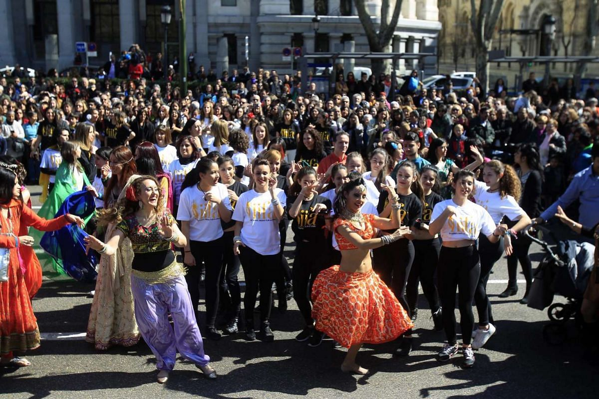 People dance during a flashmob held to promote the Bollywood Oscars in Madrid, on March 13, 2016.