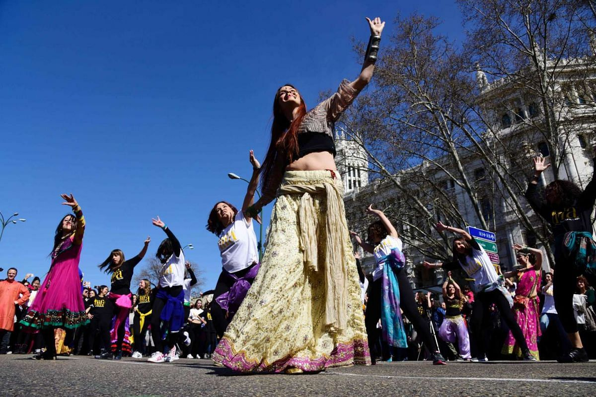 Dancers perform during a Bollywood flashmod in front of the Palacio de Cibeles in Madrid, on March 13, 2016.