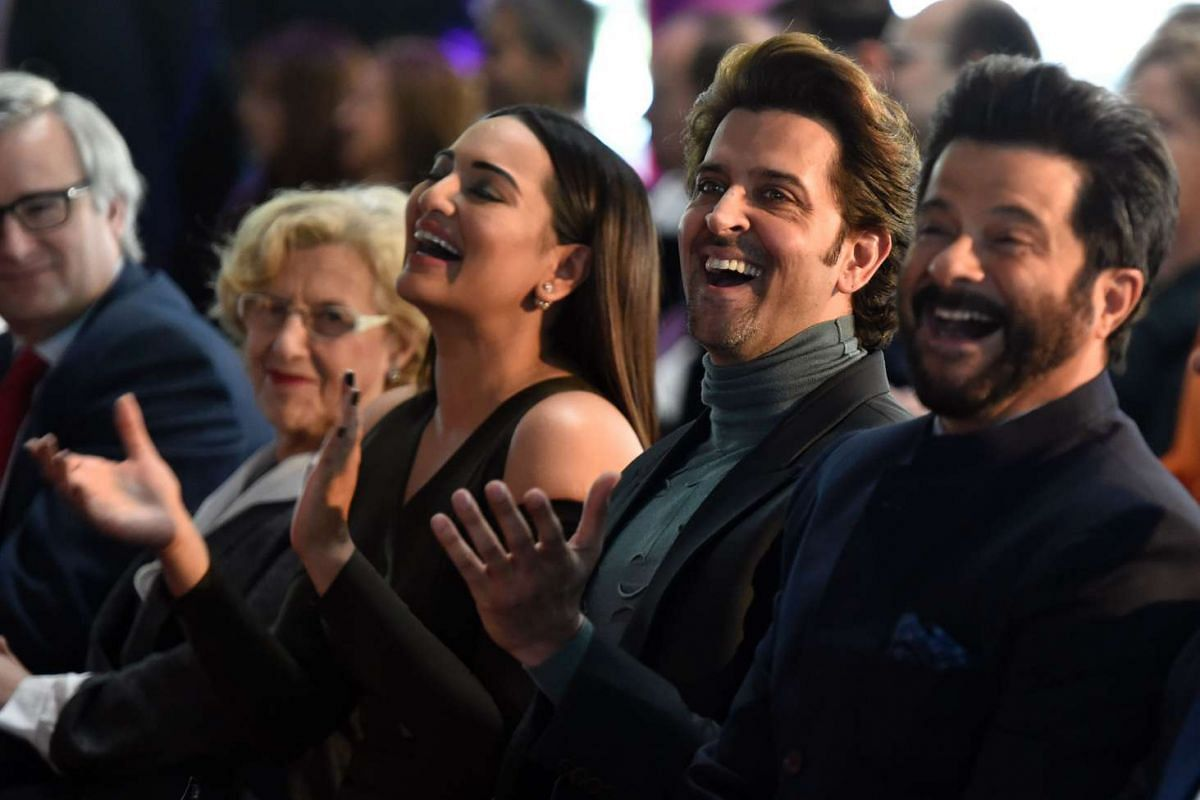Indian actors Sonakshi Sinha(left), Hrithik Roshan (centre) and Anil Kapoor laugh in Madrid, on March 14, 2016.