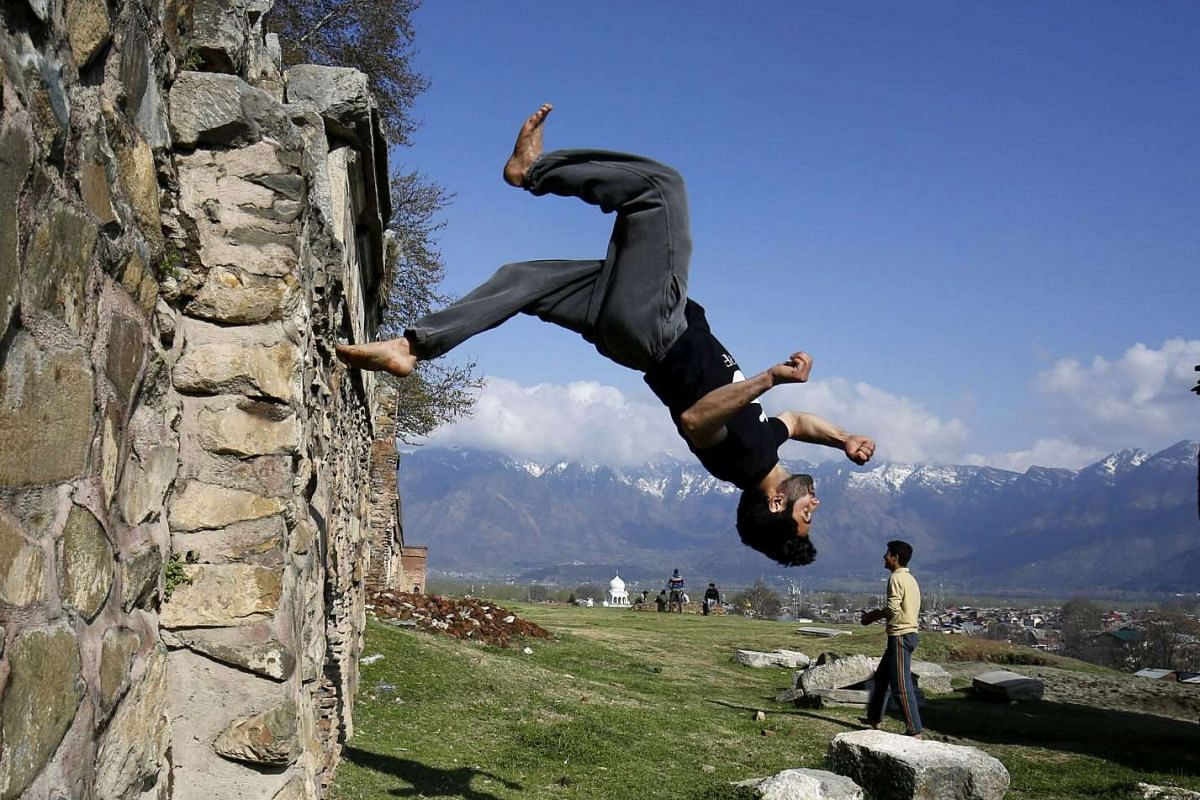 Kashmiri Muslim traceurs display their Parkour skills in an open field in the lap of Koh-e-Maraan (Hari Parbhat) hillock in downtown Srinagar, the summer capital of Kashmir, India, March 15, 2016. PHOTO: EPA