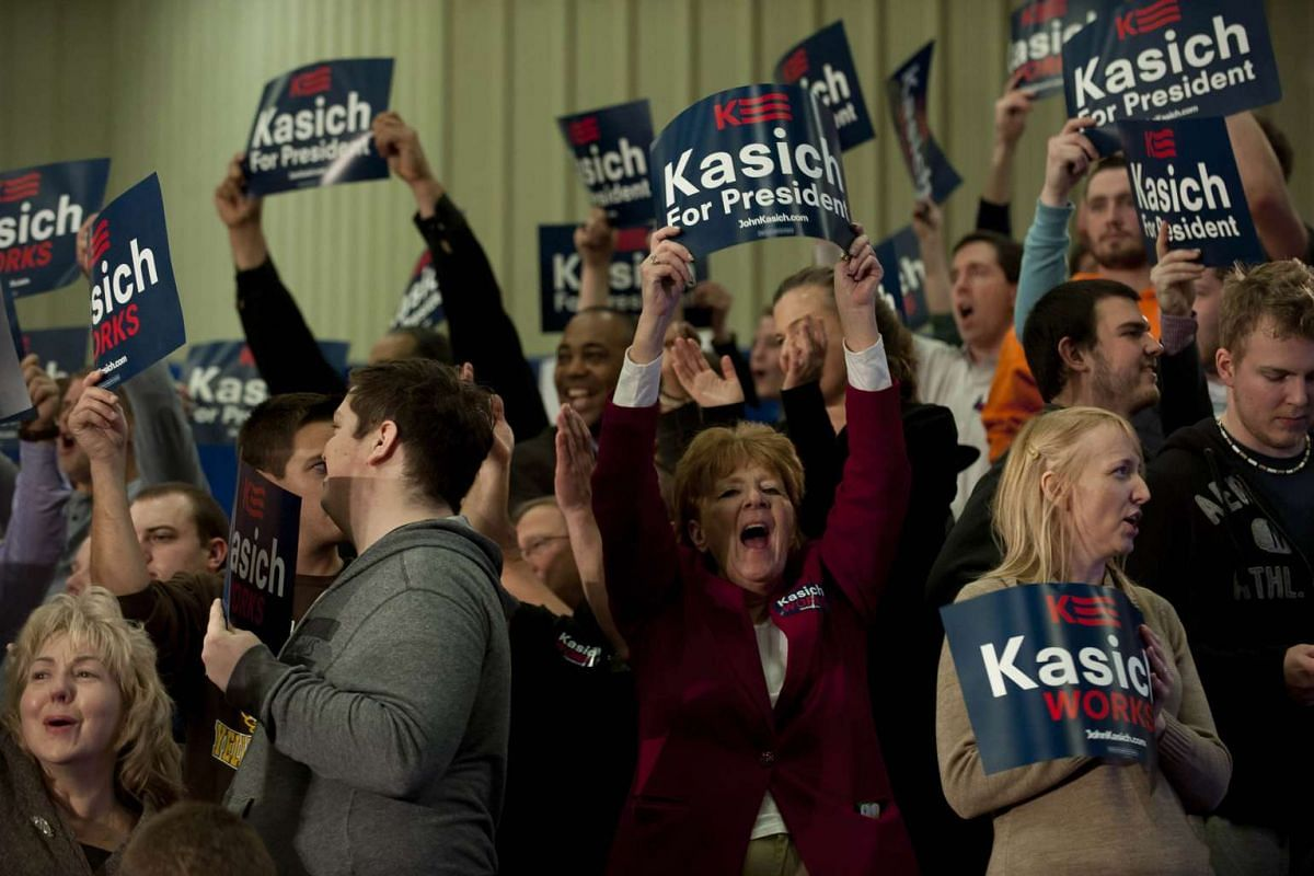 Supporters cheer Republican presidential candidate John Kasich at Baldwin Wallace University on March 15, 2016, in Berea, Ohio.