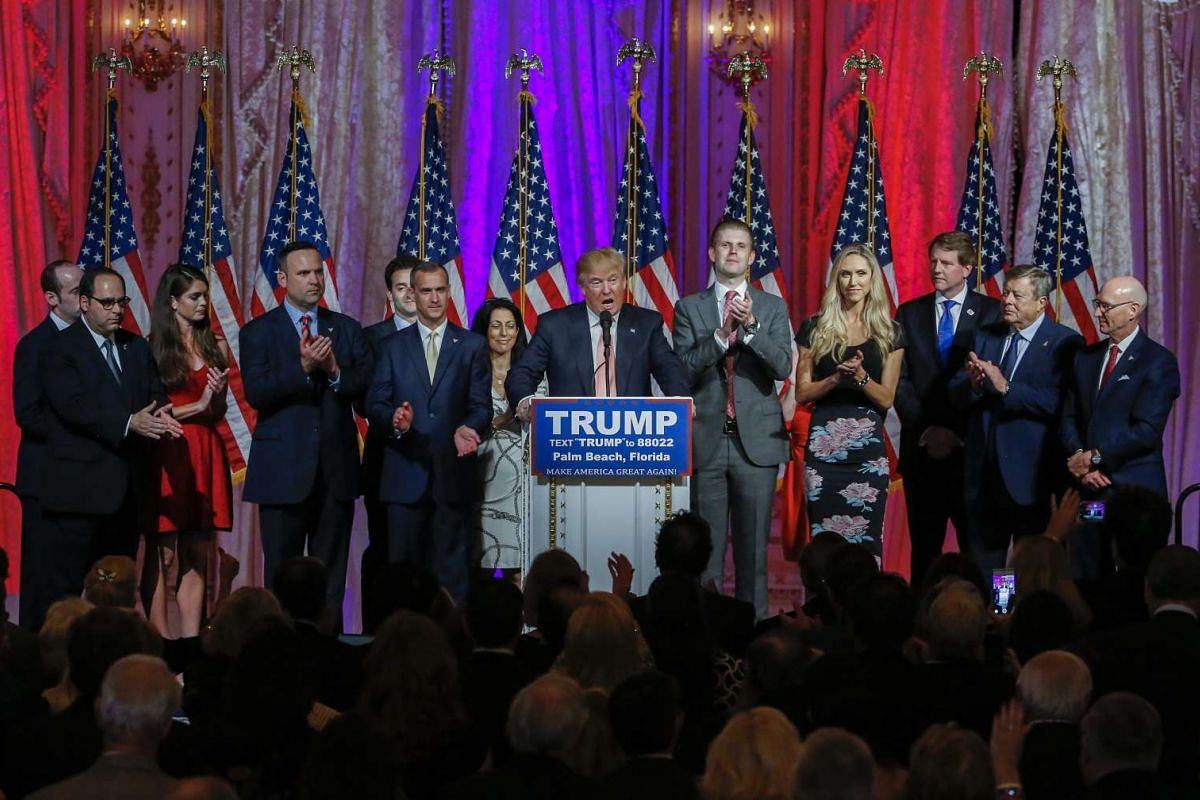 Presidential candidate Donald Trump (centre) speaks after winning the Florida Republican Primary at the Mar-A-Lago Club in Palm Beach, Florida, on March 15, 2016.