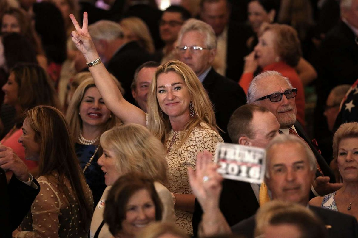Supporters celebrate as results are announced during a primary night event at Republican presidential candidate Donald Trump's Donald J. Trump Ballroom at the Mar-A-Lago Club on March 15, 2016, in Palm Beach, Florida.