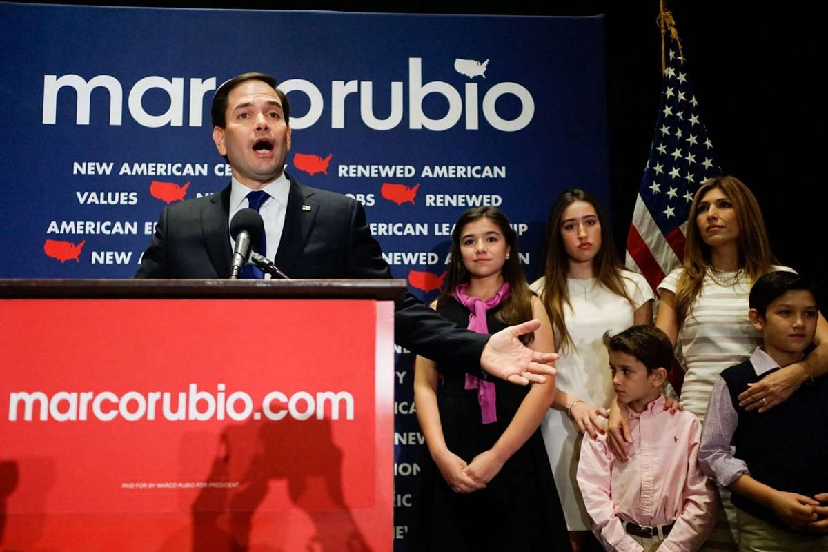 Republican presidential candidate Marco Rubio (foreground), flanked by his family, announces the suspension of his campaign after losing his home state of Florida to Republican rival Donald Trump at a primary night rally on March 15, 2016, in Miami,