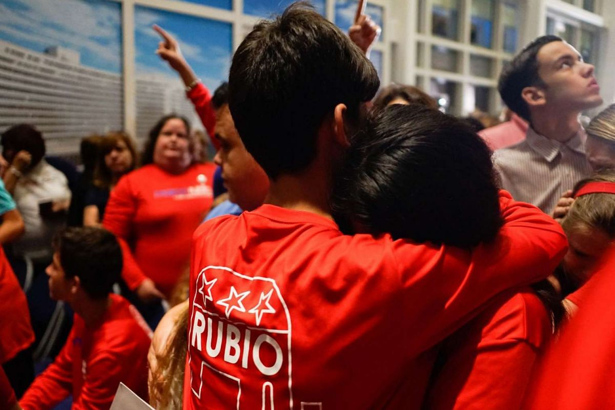 Supporters react after a primary night event for Republican presidential candidate Marco Rubio after he lost in Florida on March 15, 2016.