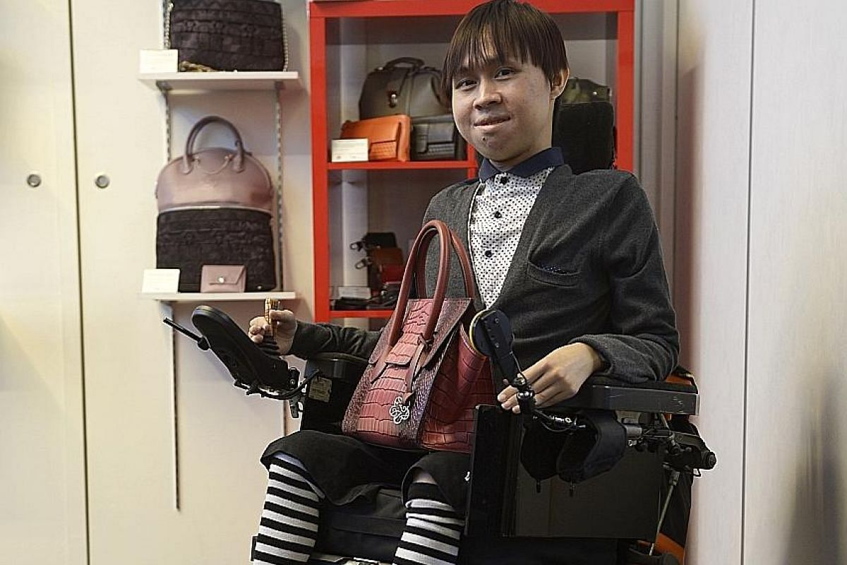 Mr Kelvin Yong, who suffers from muscular dystrophy, gets about $500 a month - including royalties - from the sale of bags he designs.