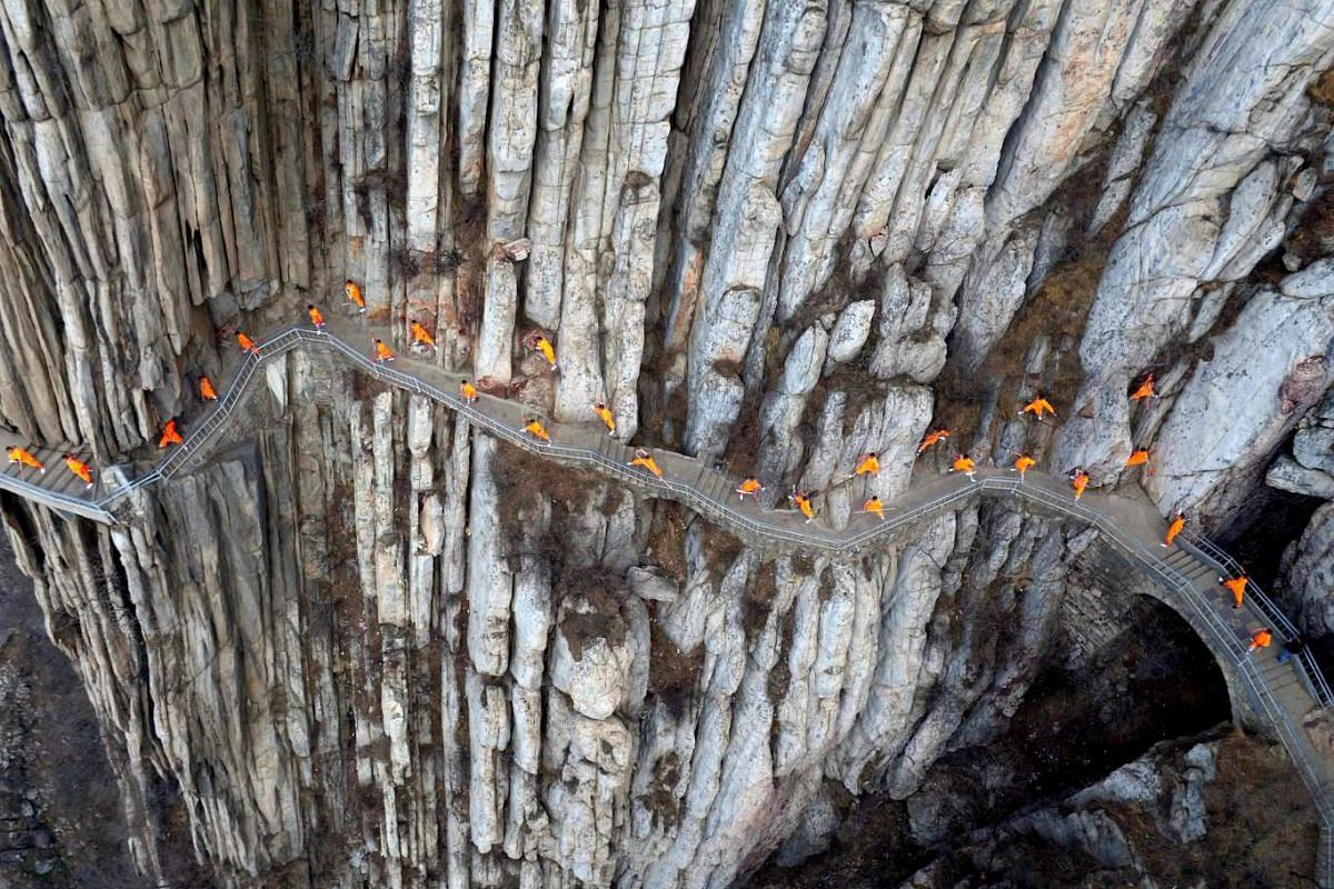 Kung fu practitioners from a local martial arts school demonstrating skills on cliffs near the renowned Shaolin Temple in Dengfeng, central China, on March 17, 2016. PHOTO: EPA