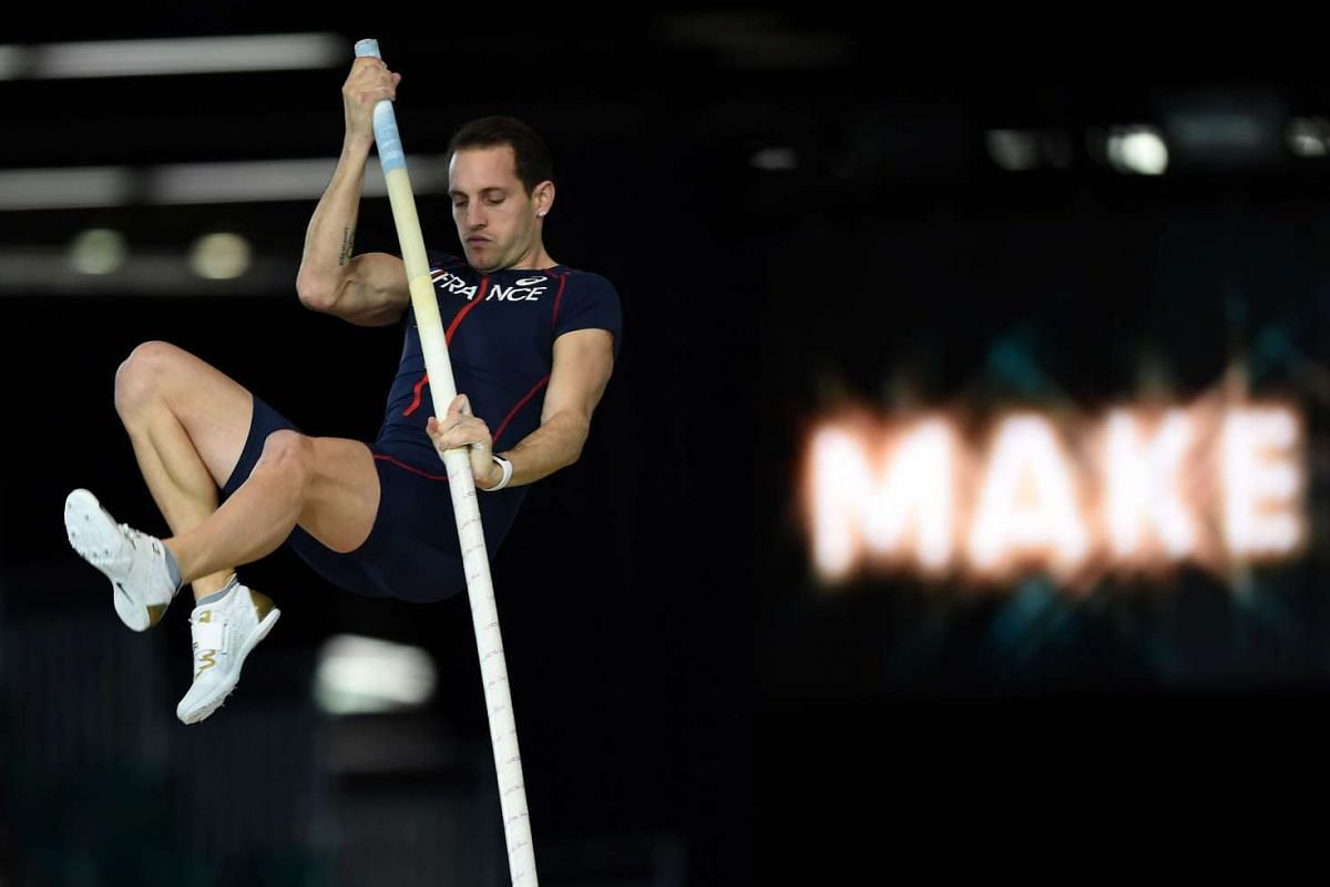 Poland's Piotr Lisek competing in the pole vault at the IAAF World Indoor athletic championships in Portland, Oregon, on March 17, 2016. PHOTO: AFP