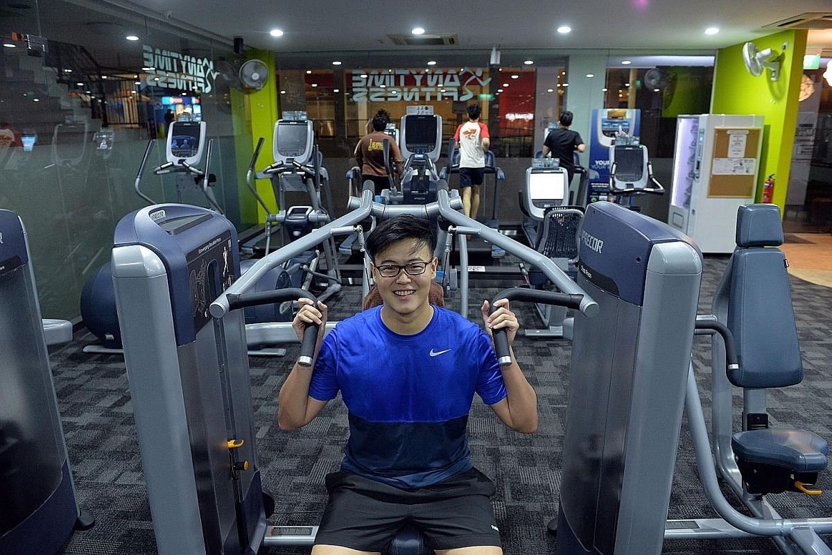 University student Shawn Lim (above) heads to Anytime Fitness Taman Jurong three times a week past midnight.