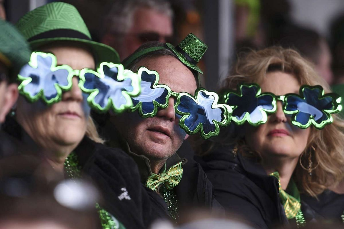 People watch the St Patrick's Day parade in Ireland, on March 17, 2016.