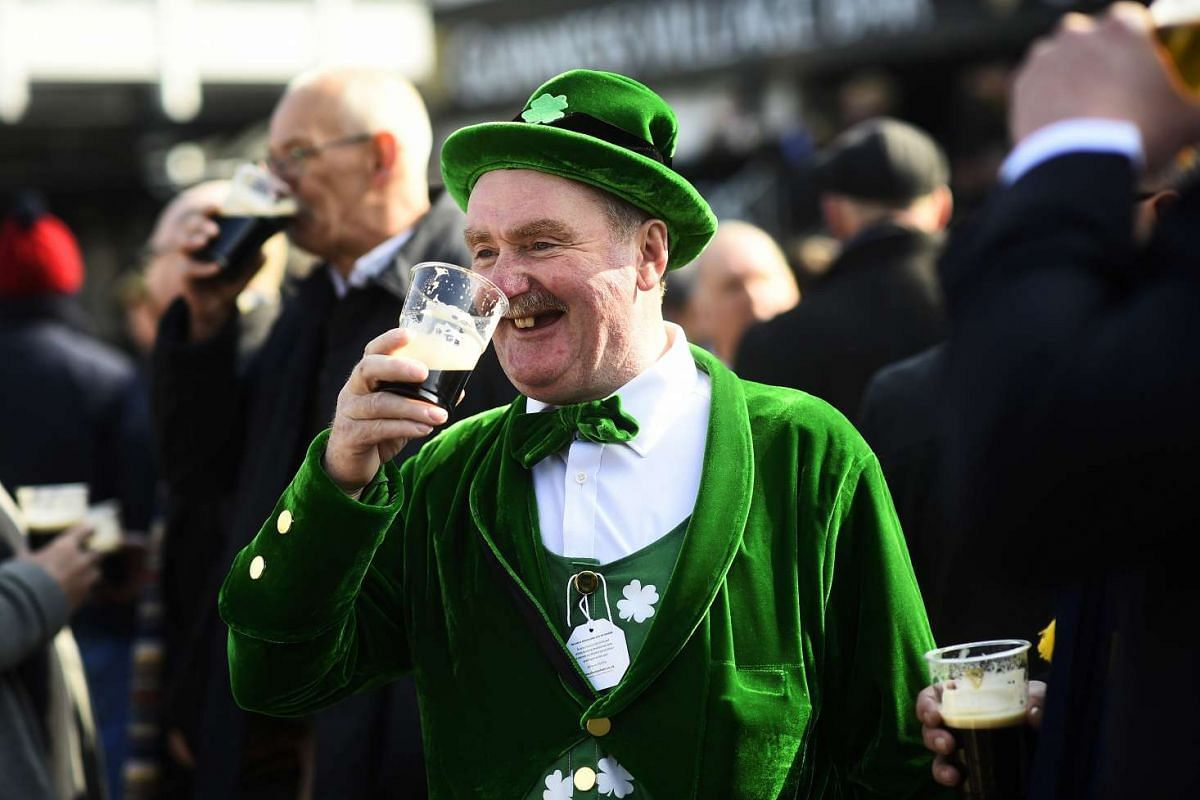 Paddy Cusack enjoys a pint of stout during St Patrick's Day at Cheltenham.