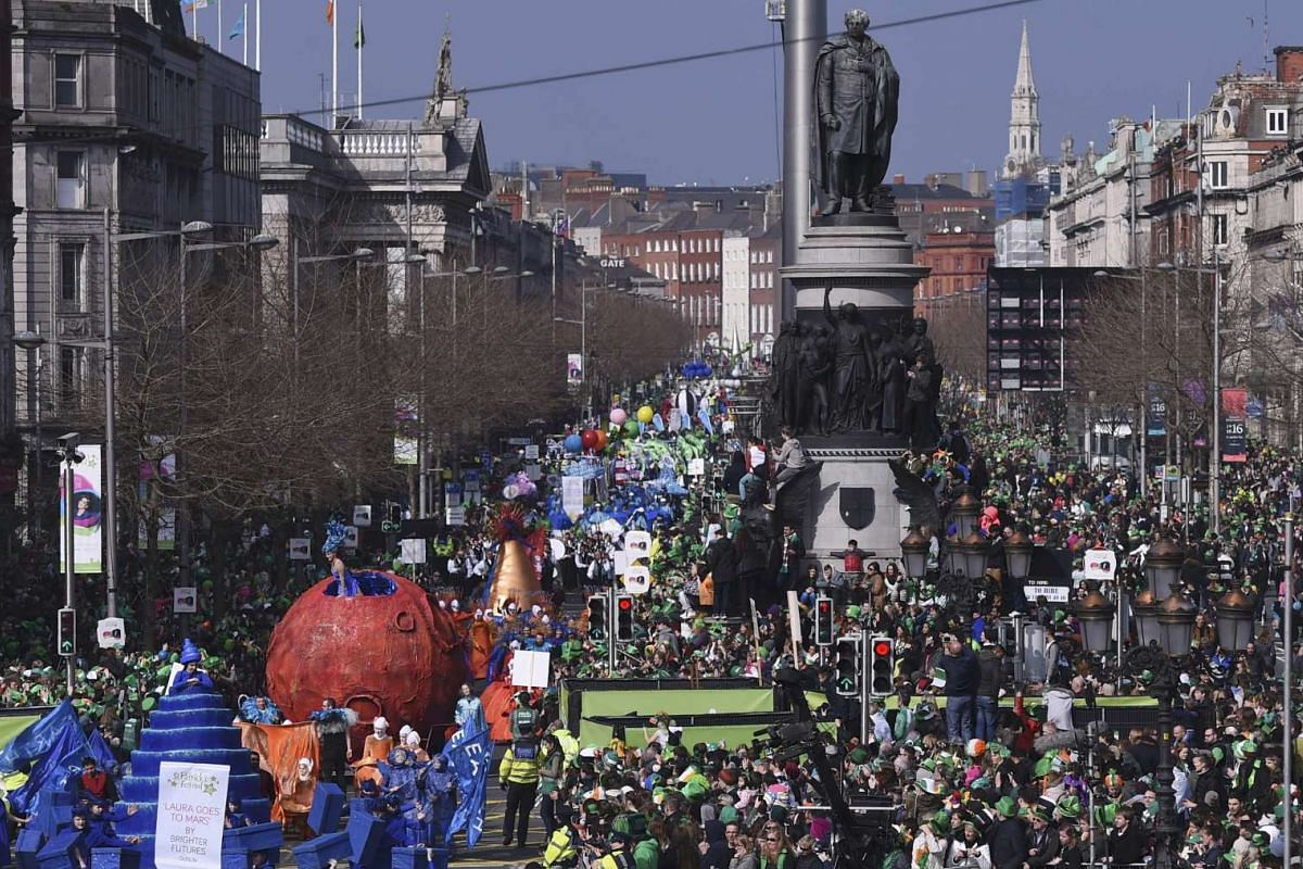 People watch the parade St Patrick's Day in Dublin, Ireland, on March 17, 2016.