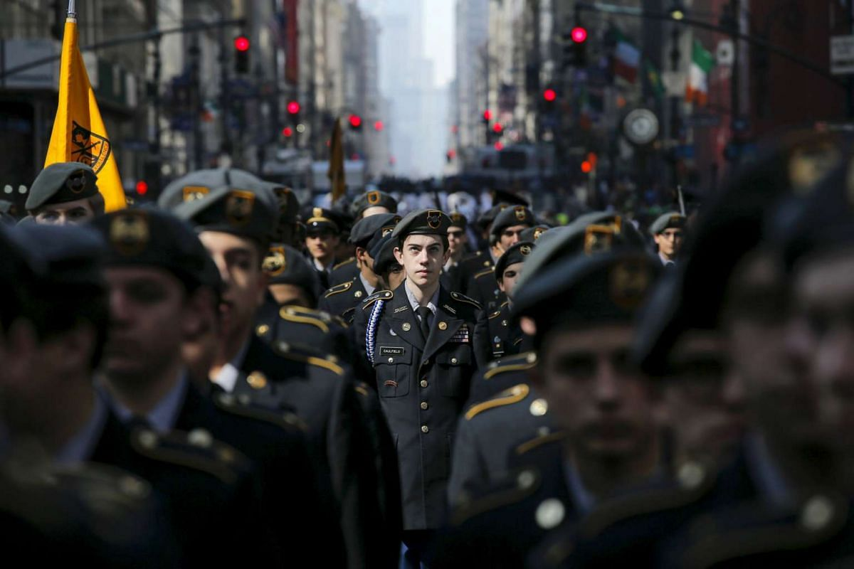 Participants march while they take part during the St Patrick's Day parade in New York, on March 17, 2016.