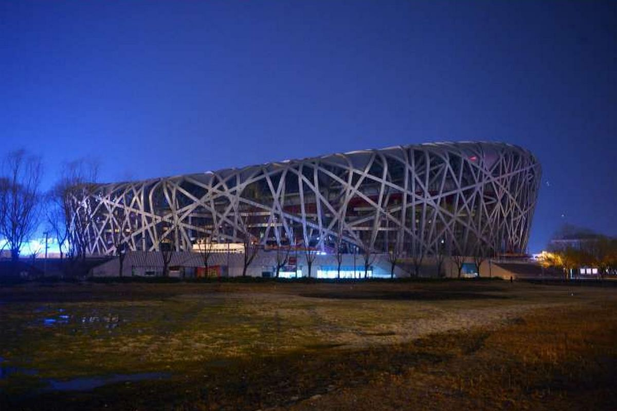 China's National Stadium, known as the Bird's Nest, during Earth Hour in Beijing on March 19, 2016.