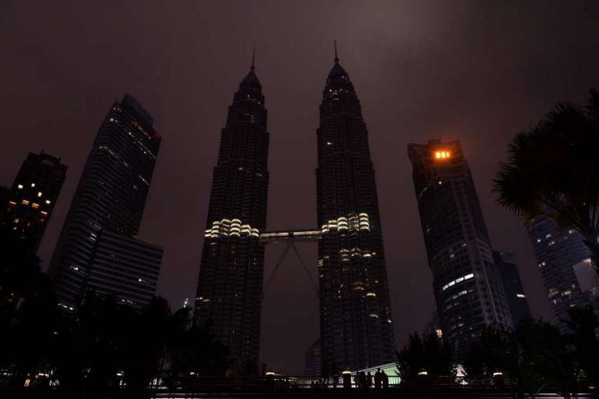 The Petronas towers during Earth Hour in Kuala Lumpur on March 19, 2016.