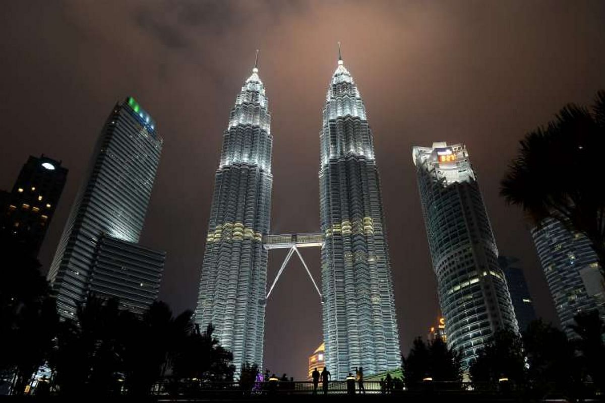 The Petronas towers before Earth Hour in Kuala Lumpur on March 19, 2016.