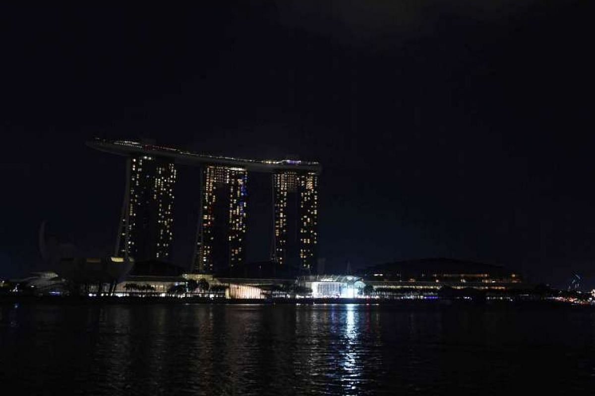 Marina Bay Sands hotel and resort during Earth Hour in Tokyo on March 19, 2016.