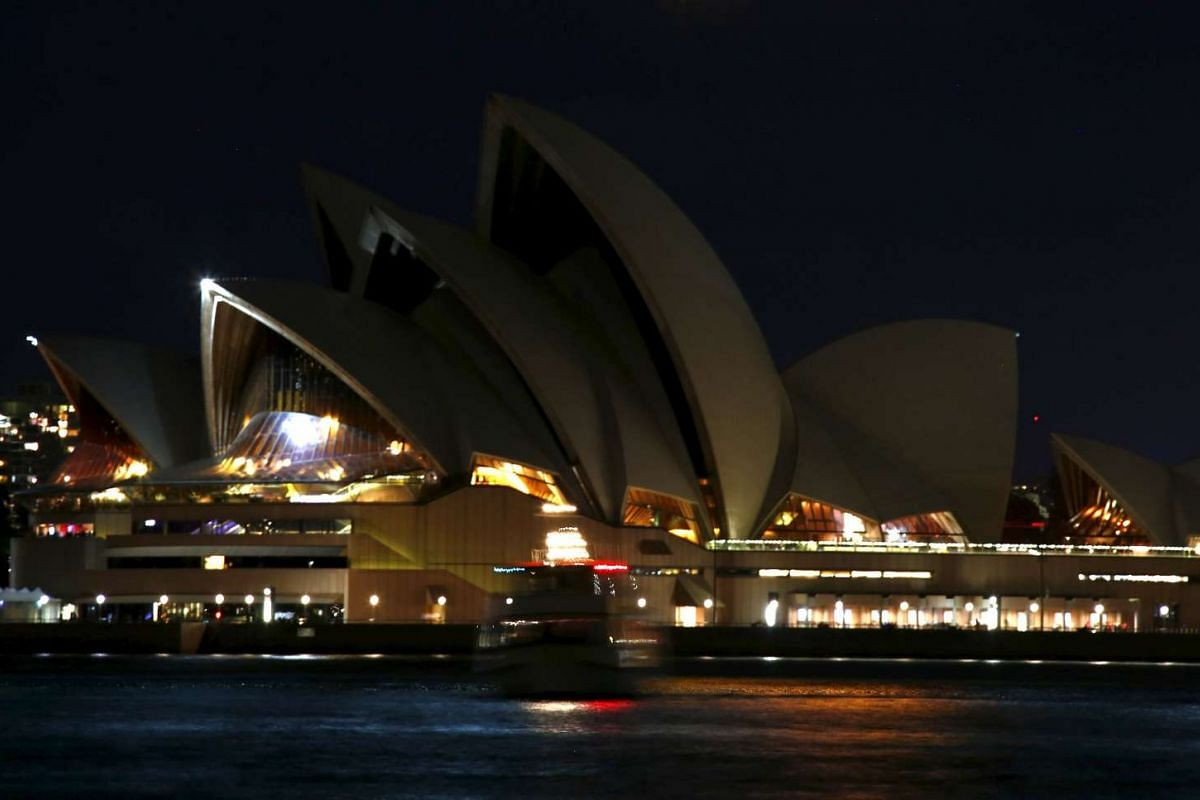 The Sydney Opera House during Earth Hour in Sydney on March 19, 2016.