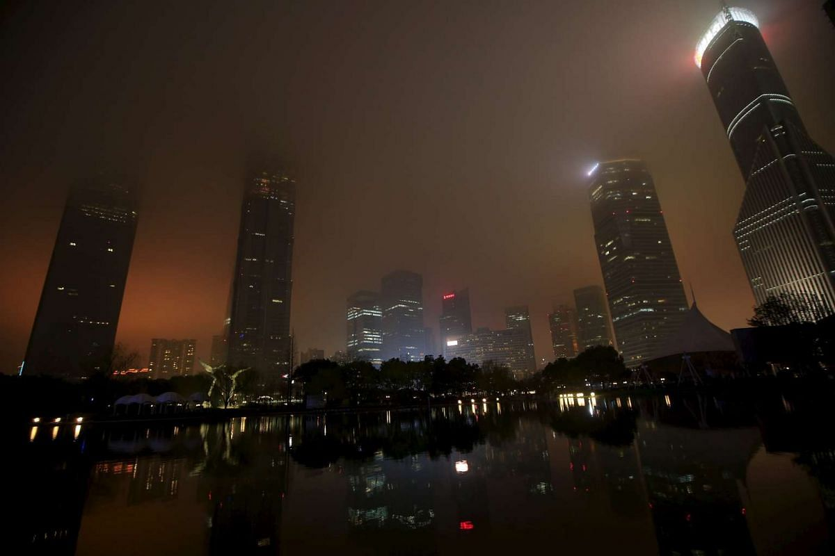 The financial district of Pudong during Earth Hour in Shanghai on March 19, 2016.