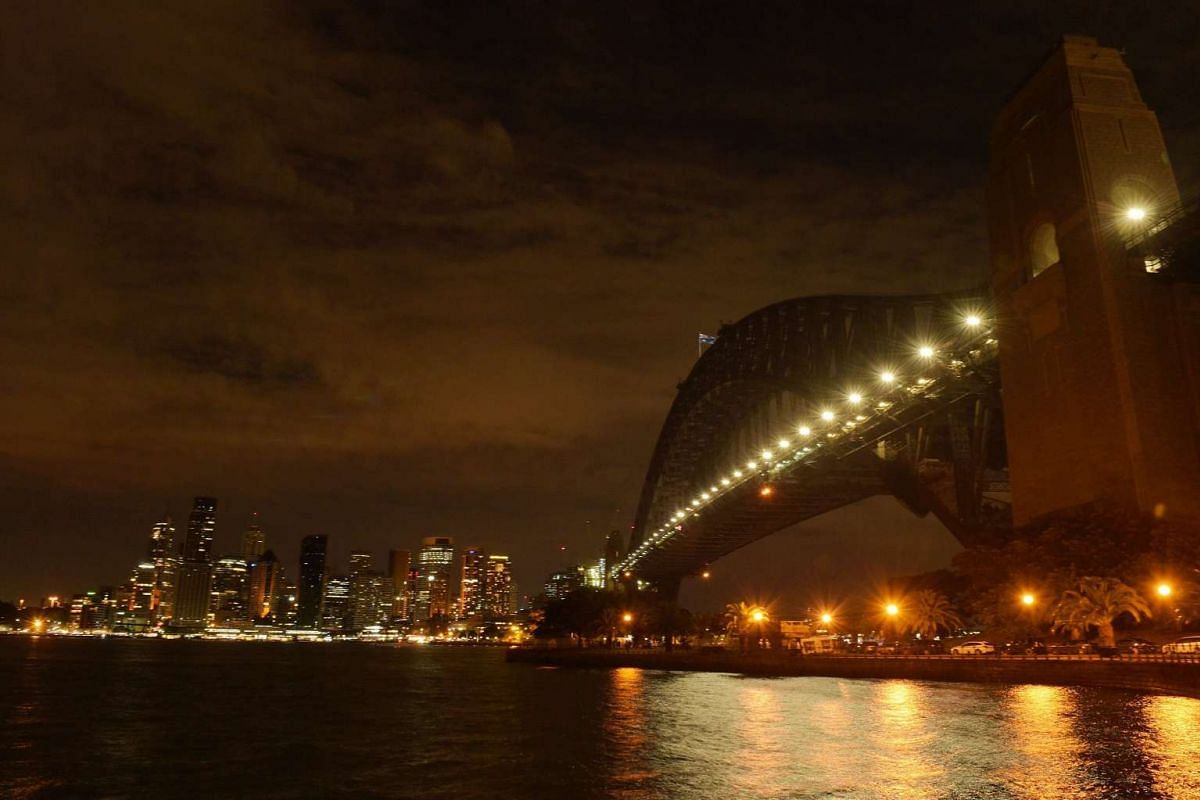 The Sydney skyline during Earth Hour in Sydney on March 19, 2016.