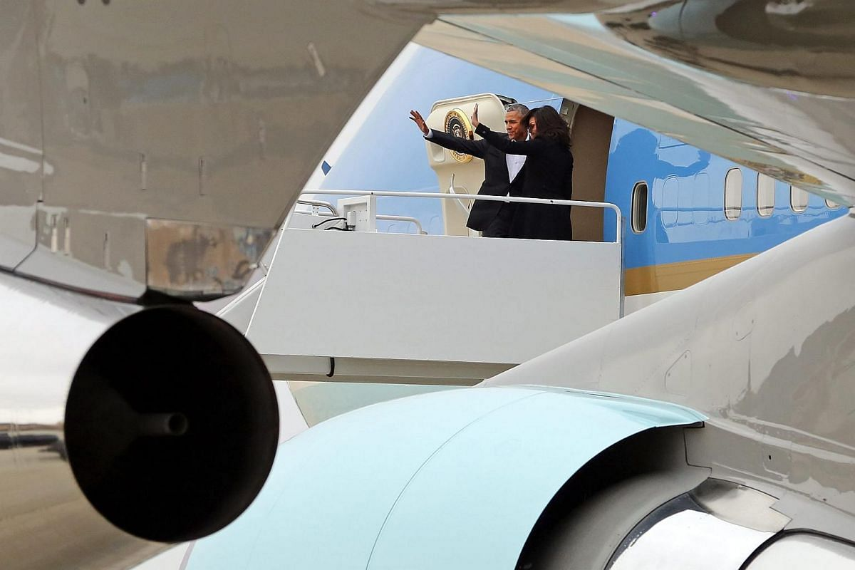 US President Barack Obama and First Lady Michelle Obama waving goodbye before their flight to Cuba.