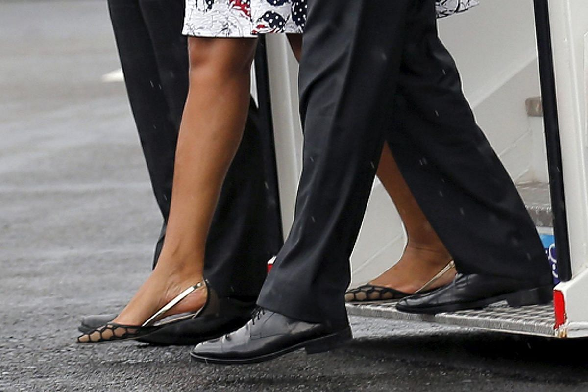 US President Barack Obama (right) and his wife Michelle taking their first steps on Cuban soil after arriving at Havana's international airport for a three-day trip.