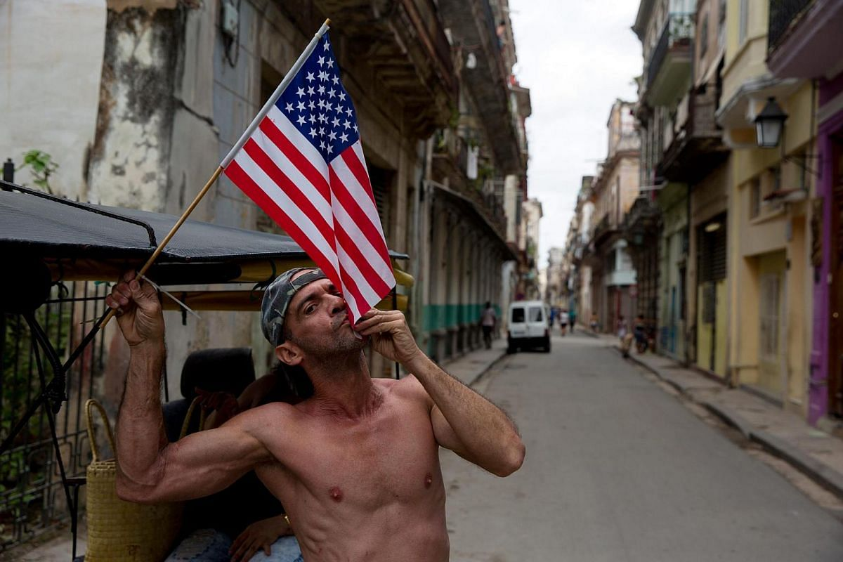A Cuban kissing the United States flag in Havana.