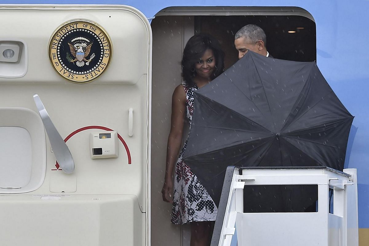 US President Barack Obama and First Lady Michelle Obama arrive at Jose Marti international airport in Havana, on March 20, 2016.