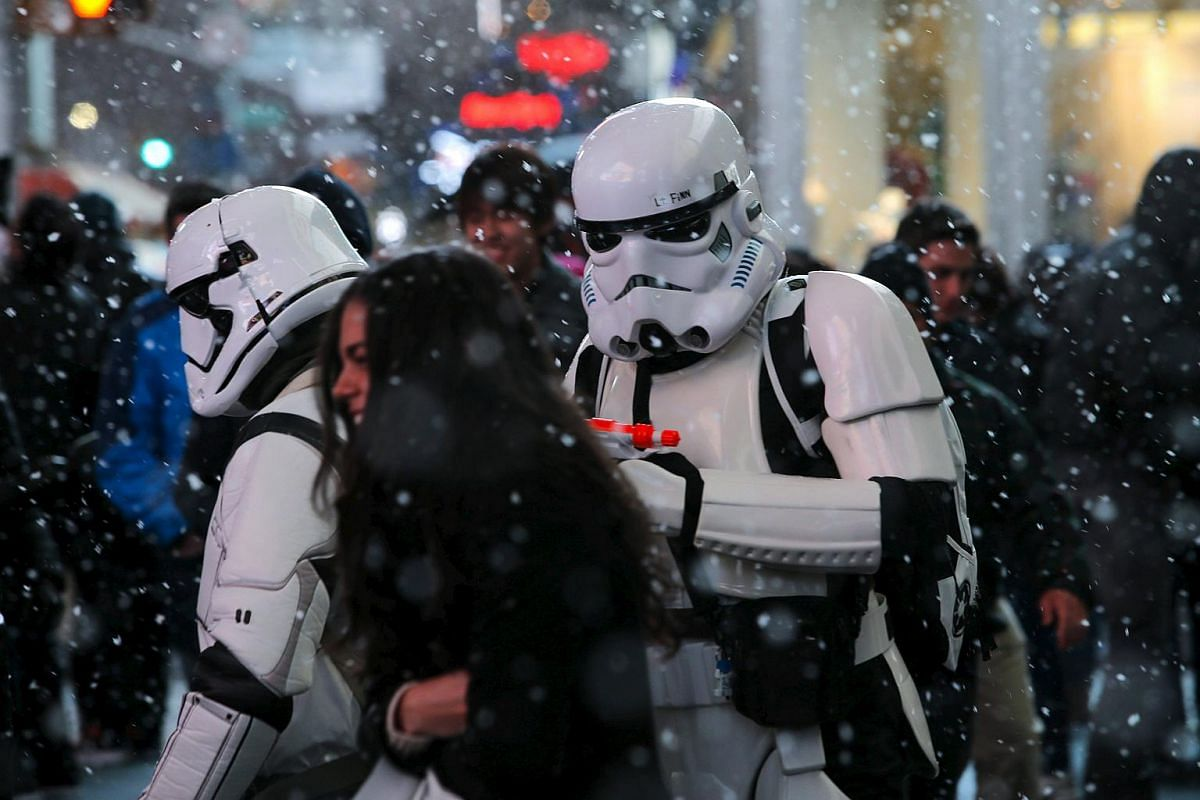 Men dressed as Storm Trooper characters from Star Wars walk in Times Square in New York, on March 20, 2016.
