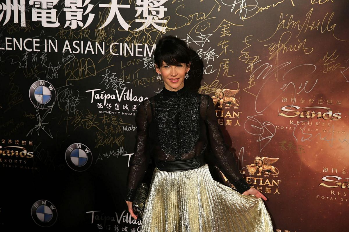 French actress Sophie Marceau walks the red carpet.