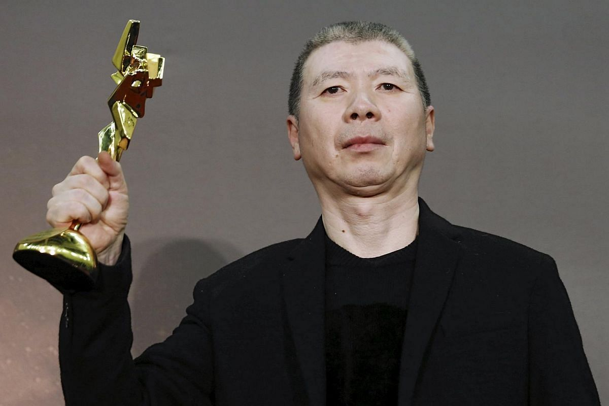 Chinese actor and director Feng Xiaogang wins the Asian Film Awards 10th Anniversary Special Award.