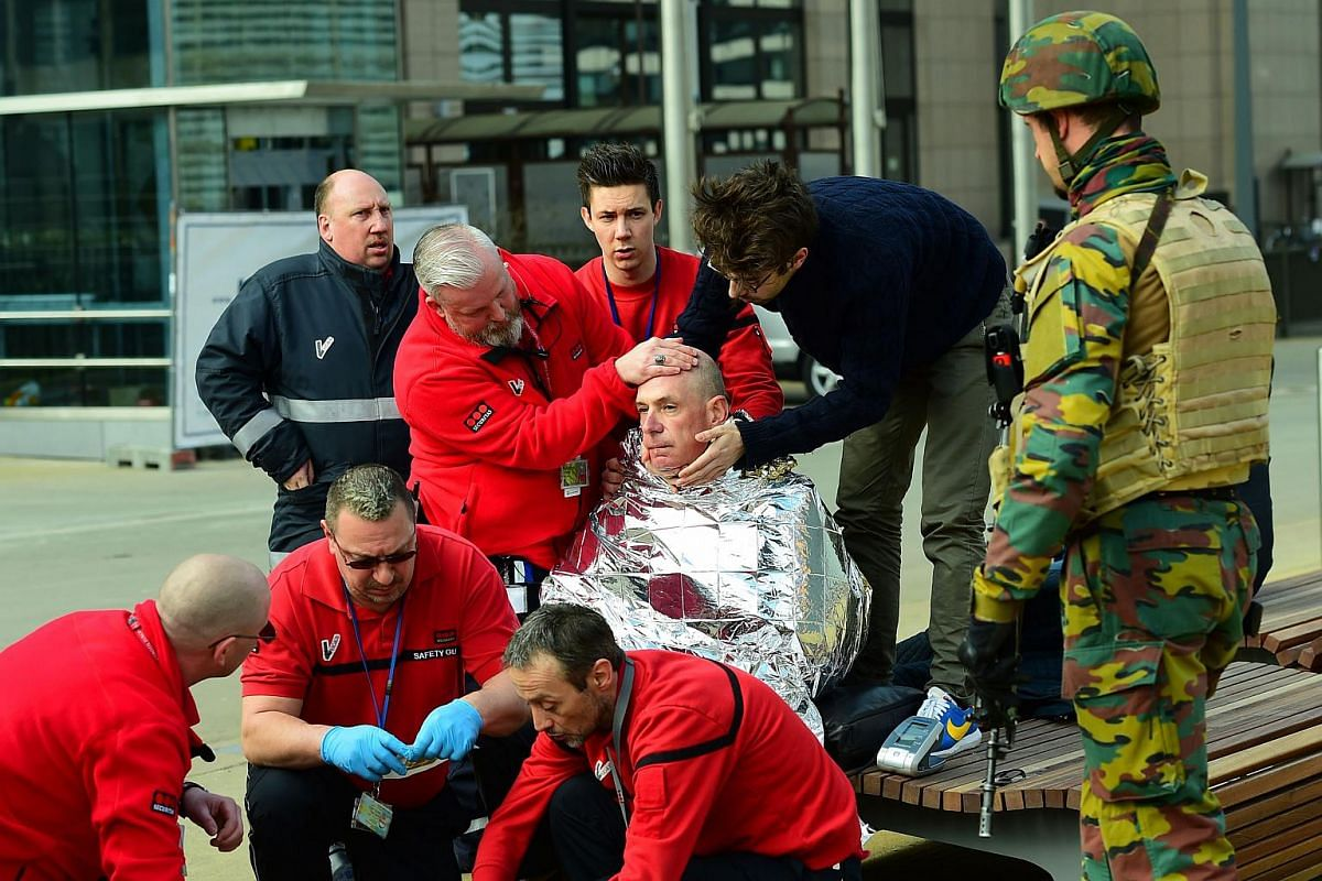 A victim receiving first aid near Maalbeek metro station in Brussels.