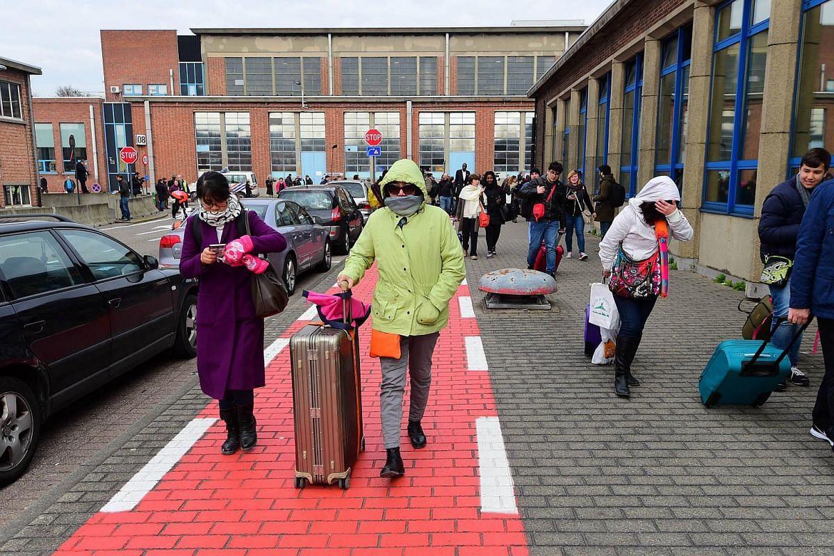Passengers evacuating the Brussels Airport on March 22.
