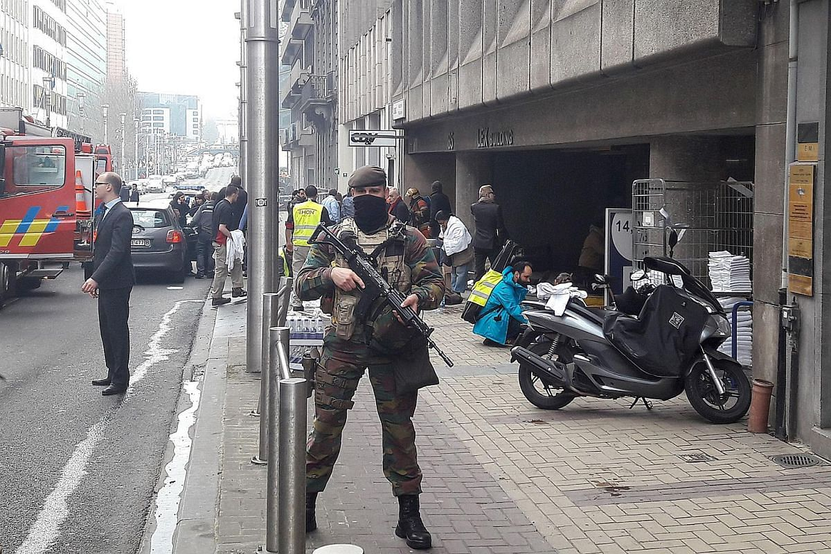 A Belgian soldier standing guard outside the Maalbeek metro station in Brussels on March 22.