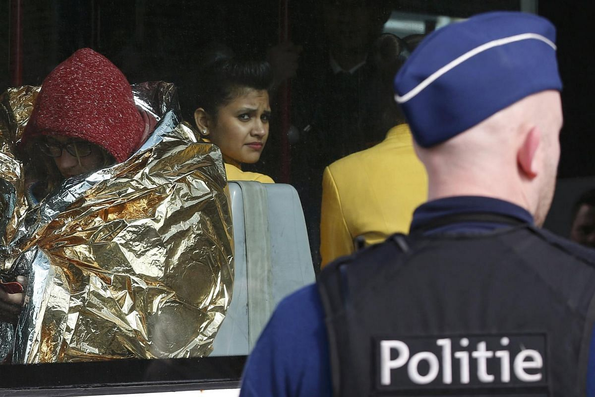 People are driven away from the scene at the Brussels Airport on March 22.