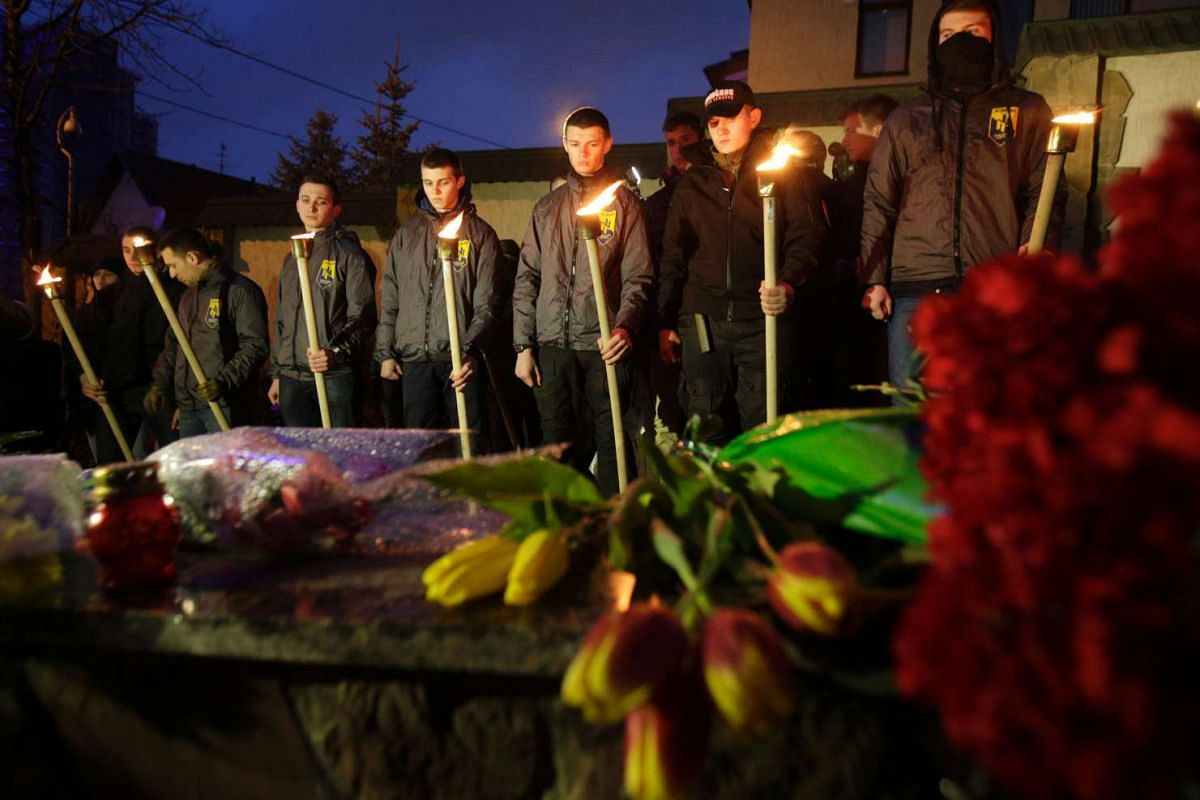 Soldiers from the Ukrainian volunteers battalion holding torches in front of the Belgian embassy in Kiev on March 22.