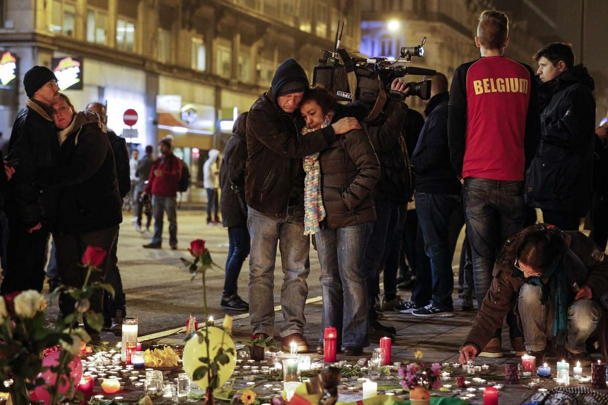 People gathering at the Place de la Bourse during a vigil for the victims of the Brussels attacks on March 22.
