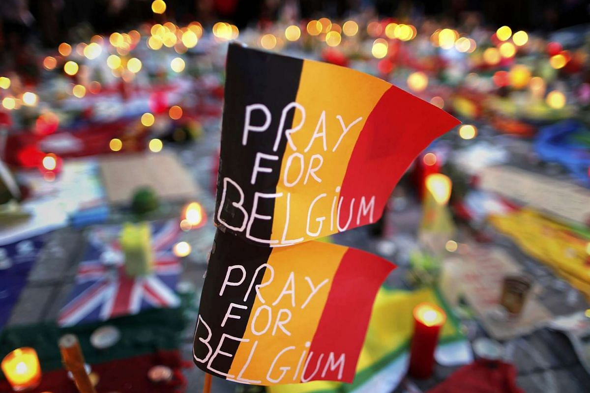 Belgian flags seen at a street memorial service in Brussels following the March 22 bomb attacks, on March 23, 2016.