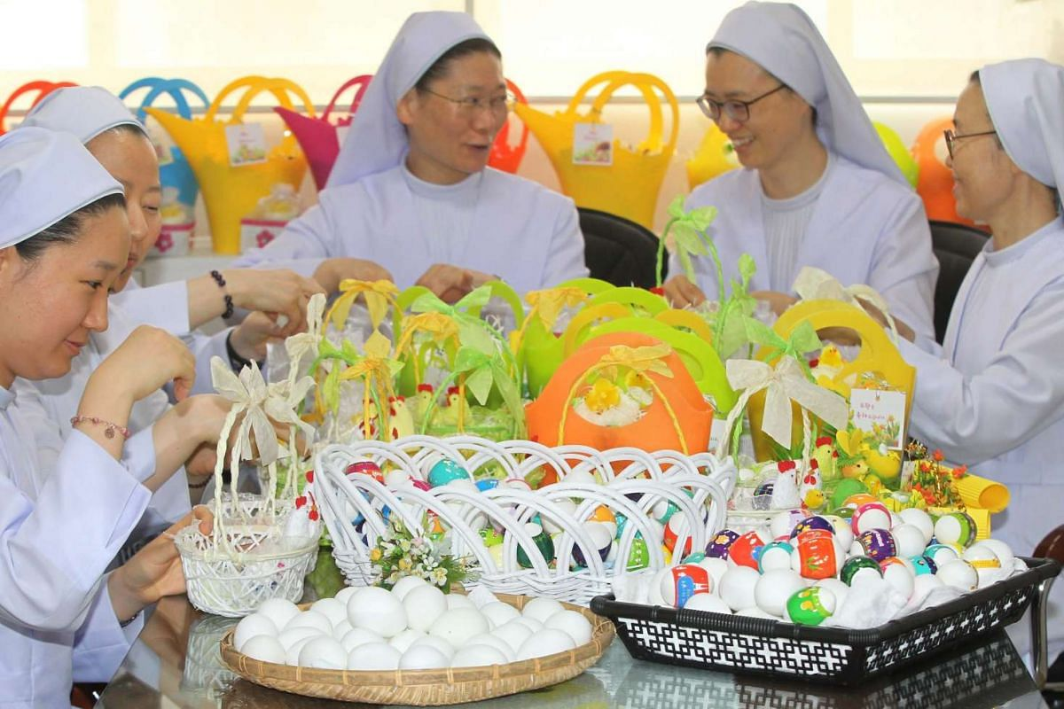 Nuns put decorated Easter eggs into baskets in preparation for Easter Sunday at a Catholic hospital in the central city of Daejeon, South Korea, on March 23, 2016.