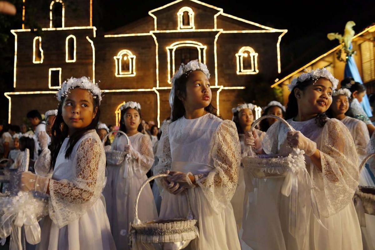 Filipino children participate in a procession before a mass to mark Easter Sunday outside a church in Las Pinas City, south of Manila, Philippines, on March 27, 2016.